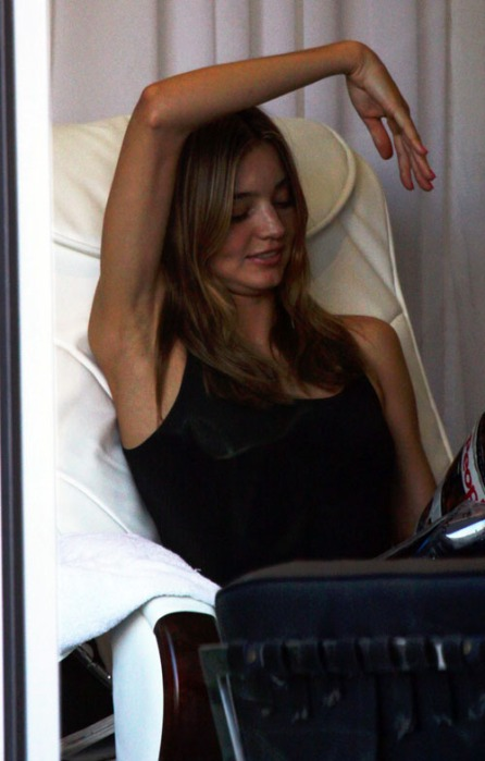 EXCLUSIVE: Miranda Kerr Reading Tabloid While Getting Nails Done
